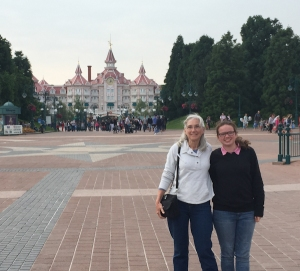 Kenna and Celeste at entrance to Disneyland Paris